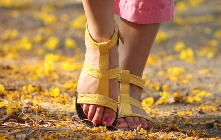 lady wearing yellow sports sandals