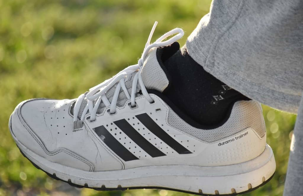 man outdoors wearing classic sports sneakers