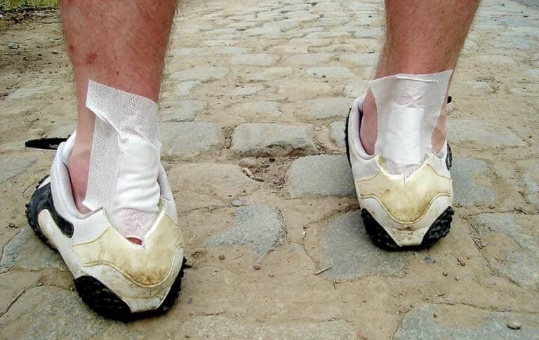 man with a patch wundpflaster sports shoes injury trauma
