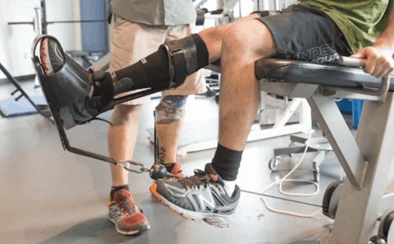 man with injured right knee sitting