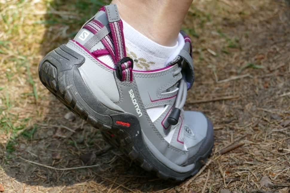person wearing grey and pink hiking sports shoes