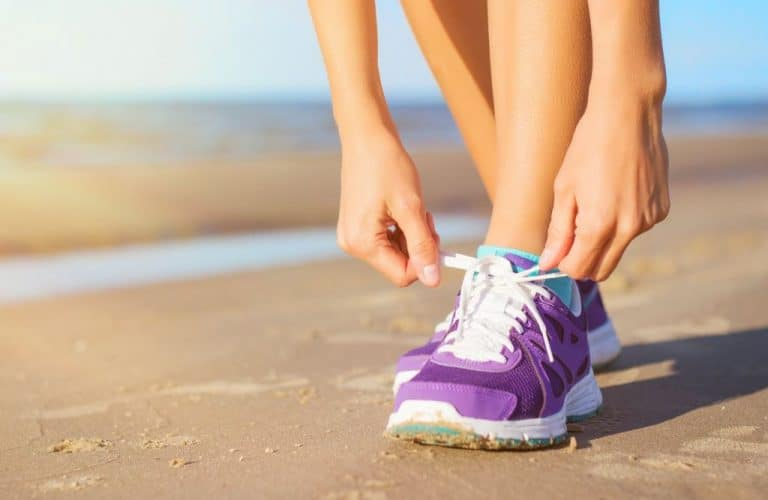 woman in sports shoes and sportswear