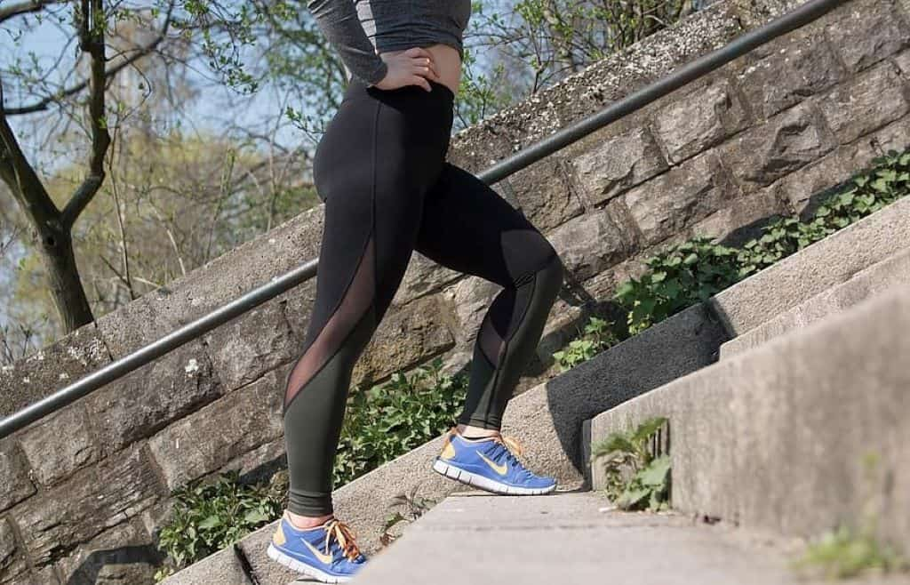 woman walking up the stairs exercising