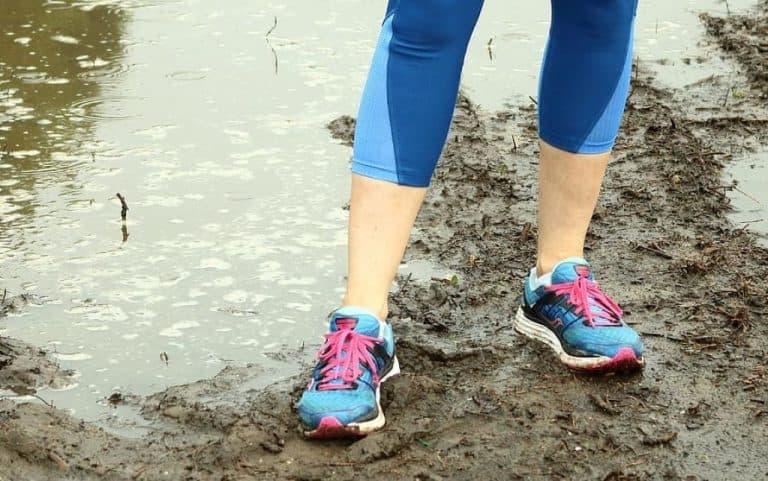 woman wearing running sports shoes and blue tights