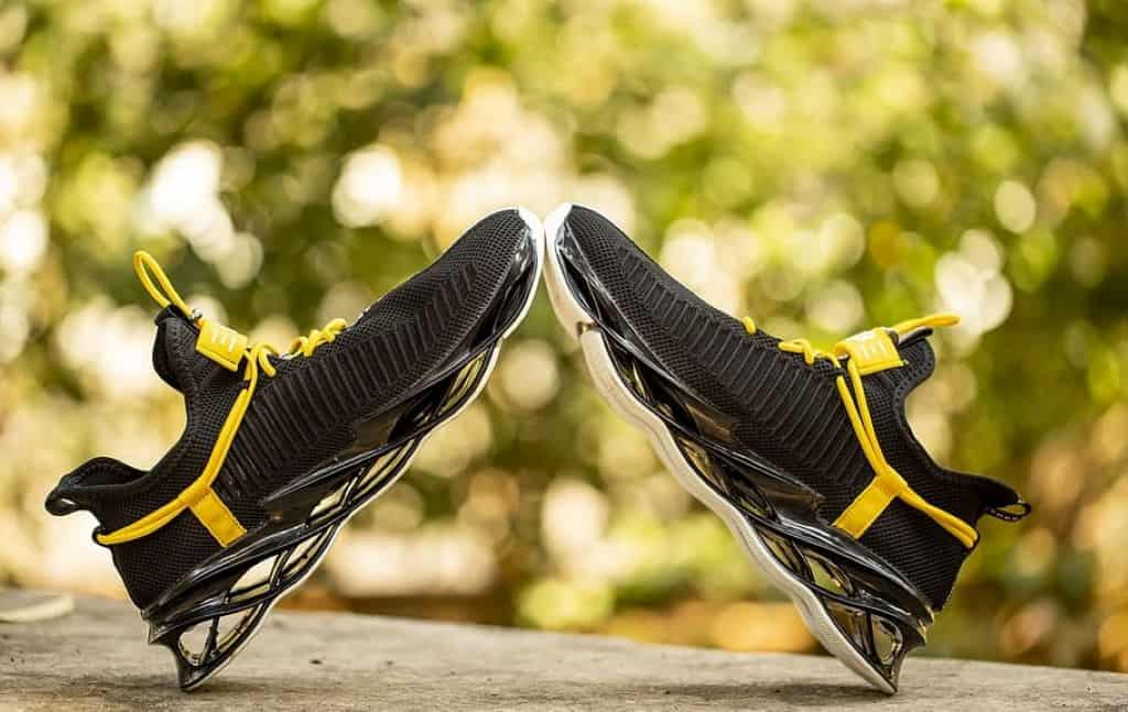yellow and black sneakers in a flat surface