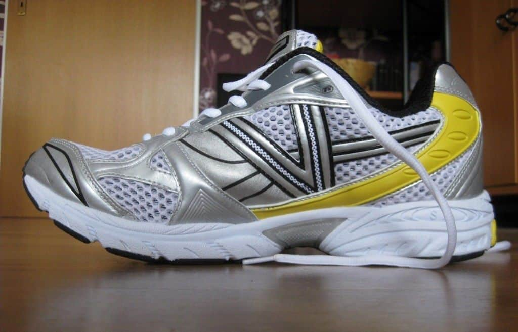 black and yellow tennis sports shoes