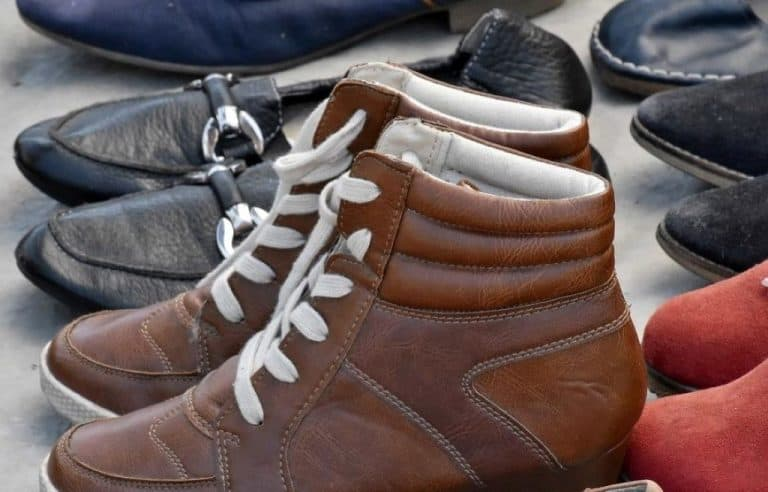 pair of leather footwear and boots
