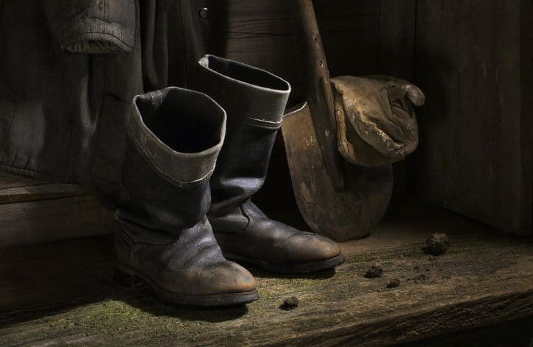 retro work boots and a shovel