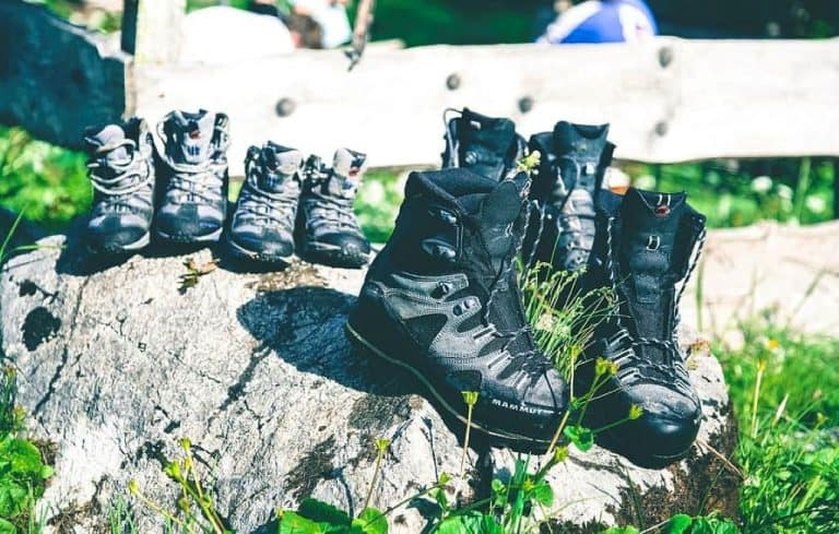 running shoes and trail boots on rocks